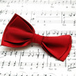 Stock Photo: Bow tie on sheet of printed music