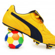 Stock Photo: Yellow soccer footwear and color football isolated on white - more footwar