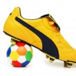 Yellow soccer footwear and color football isolated on white - more footwar — Stock Photo