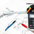 Stock Photo: Design drawings, calculator, pens and measuring tape