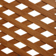 Wooden trellis with rhomb shaped holes - Stock Photo