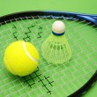 Royalty-Free Stock Photo: Tennis ball, shuttlecock and racket on green background