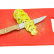 Knife and slices of green bell pepper on cutting board - Lizenzfreies Foto