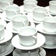 Cups and saucers stacked on top of each other — Stock Photo