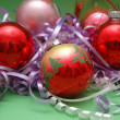 Various christmas decorations on the green background - Stock Photo