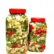 Two jars with pickles isolated on white - Stock Photo