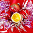 Christmas decorations on red background — Stock Photo #4428891