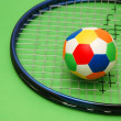 Tennis racket and football — Stock Photo
