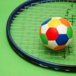 Tennis racket and football — Stock Photo