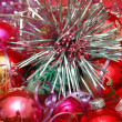 Various Christmas decorations on red background — Stock Photo