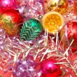 Various christmas decorations on red background - Stock Photo