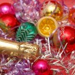 Various christmas decorations and a bottle of champagne — Stock Photo