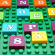 Game board with various letters — Stock Photo