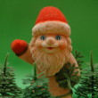 Santa Claus and trees on green background — Stock Photo