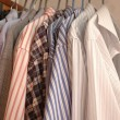 Shirts on hangers — Stock Photo