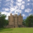 Scottish castle in the forest - Stock Photo