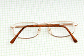 Reading glasses on the black page — Stock Photo