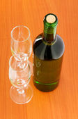 Bottle of wine on the wooden table — Fotografia Stock