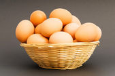 Basket of eggs on the colourful background — Stock Photo
