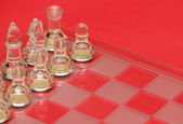 Chess figures on red background — Stock Photo