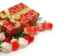 Gift box and roses isolated on white — Stock Photo