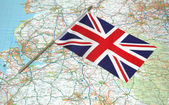 Flag of United Kingdom over the map — Stock Photo