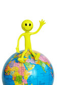 """On top of the world"" - smilie sitting on the globe — Stock Photo"
