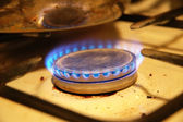 Blue flames from the dirty gas stove — Stock Photo
