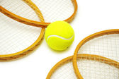 Four tennis rackets and balls isolated on white — Stock Photo