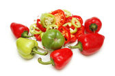 Selection of red and green peppers isolated on white — Stock Photo