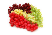 Various sorts of grapes isolated on white — Stock Photo