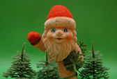 Santa Claus and trees on green background — Stockfoto