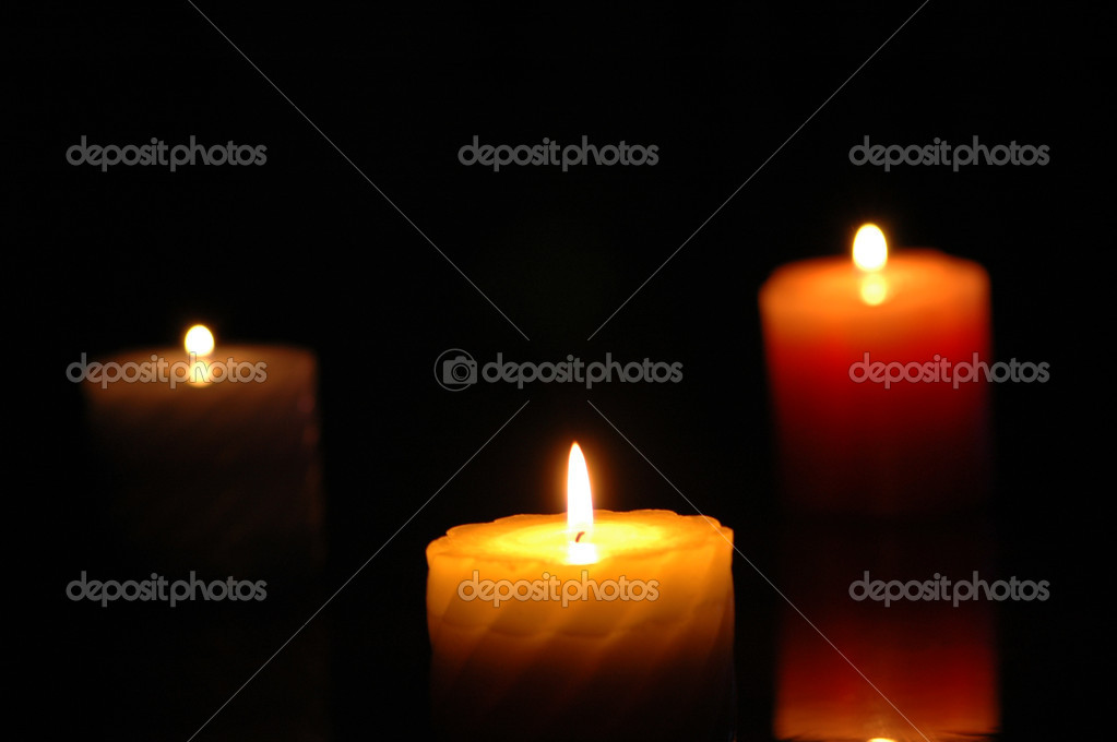 Three candles in the darkness - focus on the middle one — Foto Stock #4424501