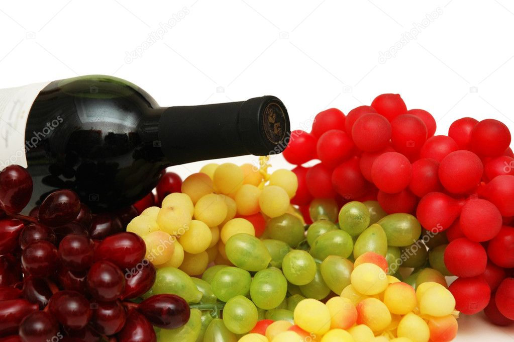 Various sorts of grapes with bottle of wine — Stock Photo #4429040