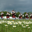 Royalty-Free Stock Photo: Scottish Pipe Band marching on the grass