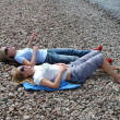 Two girls relaxing at the beach — Stock Photo