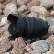 Camera lens on pebbles — Foto Stock