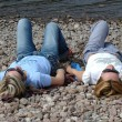 Two girls relaxing at the beach — Stock Photo #4430858