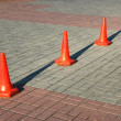 Red cones aligned in row - Stock Photo