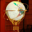 Globe with golden frame on the table — Stock Photo