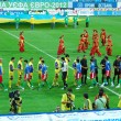 Two football teams greeting each other - Stock Photo