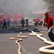Fire hoses stretching across the street during fire — Stock Photo