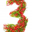Numbers with green and red peppers — Stock Photo