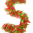 Numbers with green and red peppers - Stock Photo