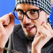 Man with glasses in studio shooting — Stock Photo #4439740
