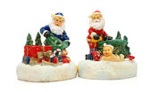 Figures of Santa Claus isolated on white — Stock Photo