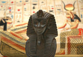 Figure of sphynx and background with elements of egyptian ancient history — Stock Photo