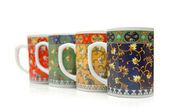 Four colourful mugs isolated on white — Stock Photo