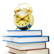 Back to school concept with books and clock — Stok fotoğraf
