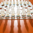Set of chess figures on the playing board — Stockfoto